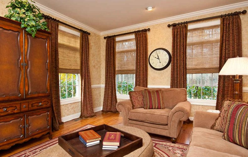 Traditional Drapery Panels And Wood Shades