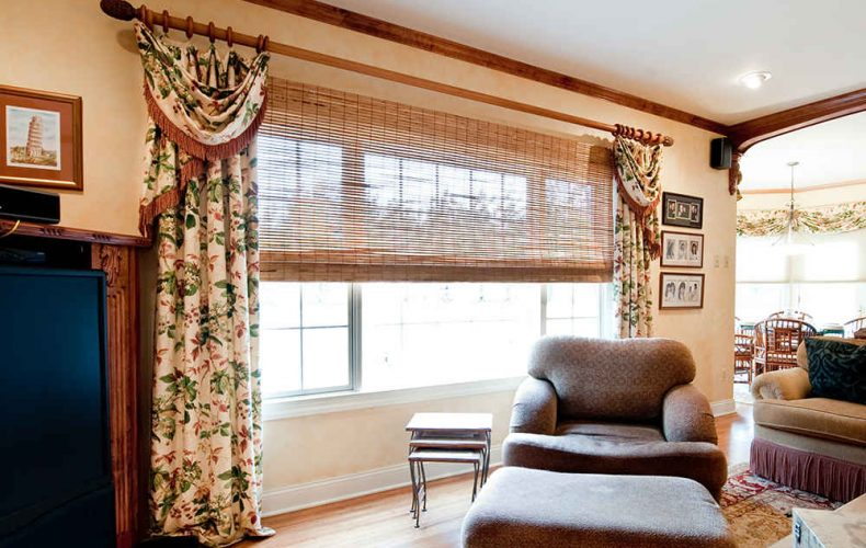 Traditional Drapery Panels And Woven Wood Shades